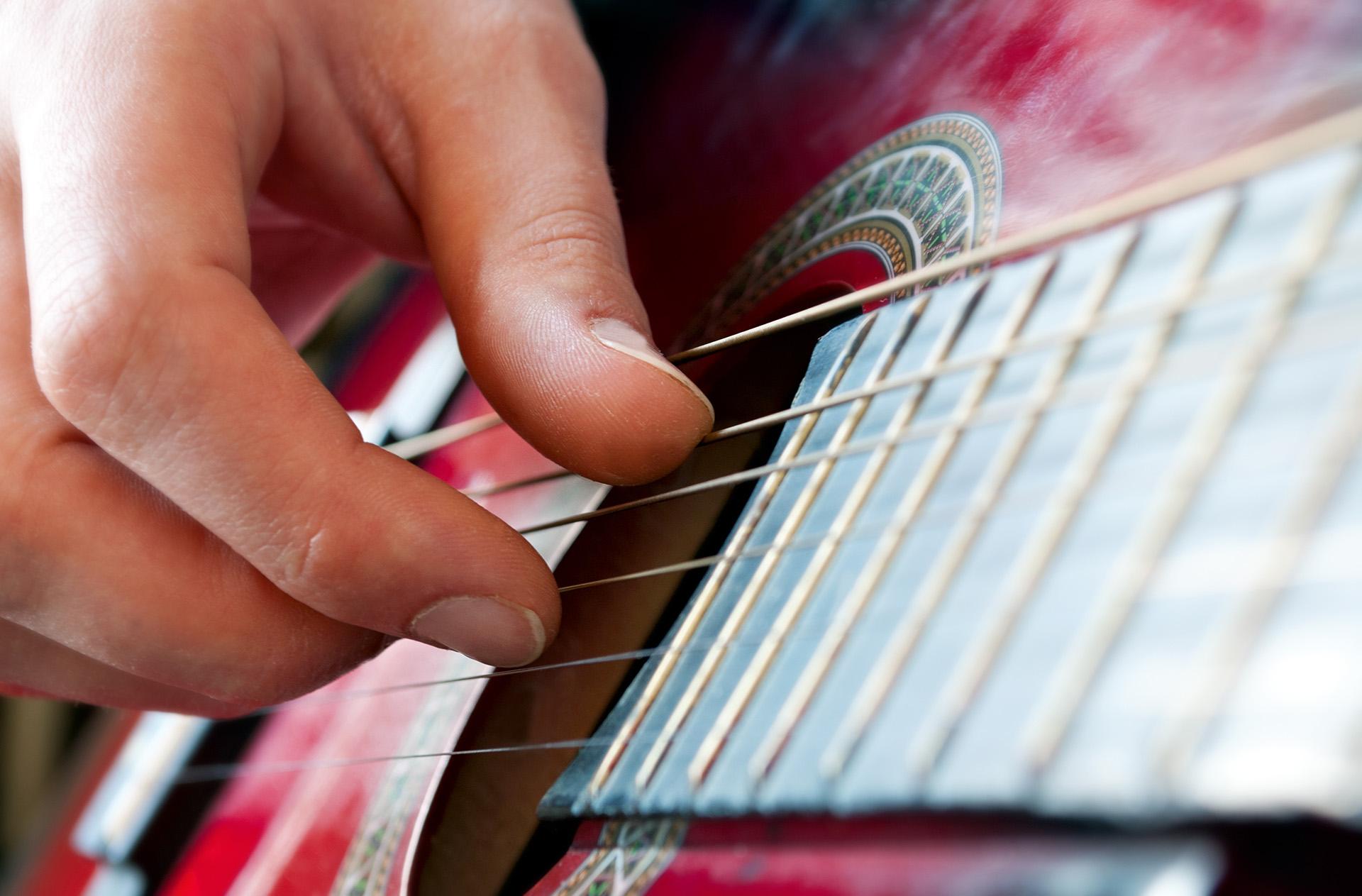 man playing a guitar
